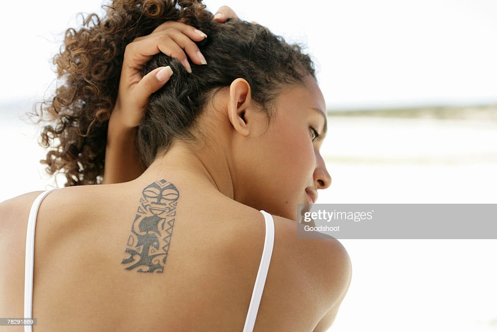 Woman's neck with tattoo : Stock Photo