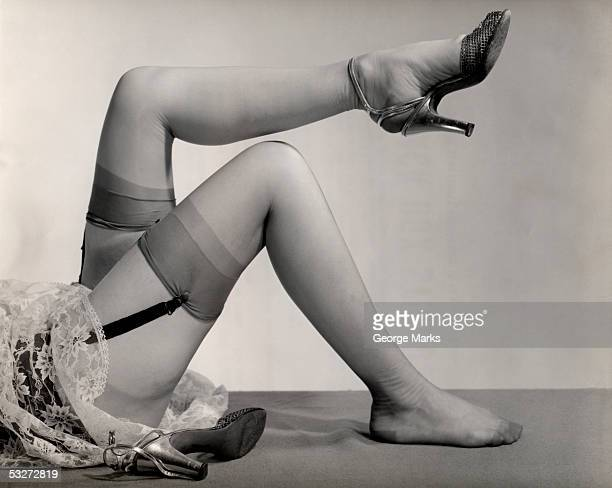 Woman's nylon stocking legs with garters and heels
