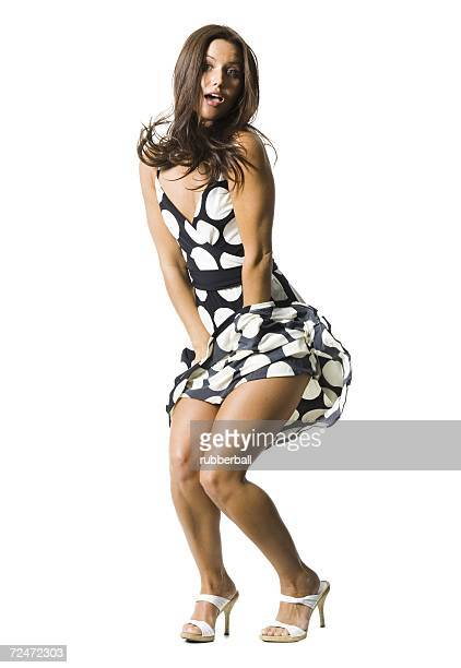 woman's polka dot dress blowing in breeze - wind blows up skirt stock pictures, royalty-free photos & images