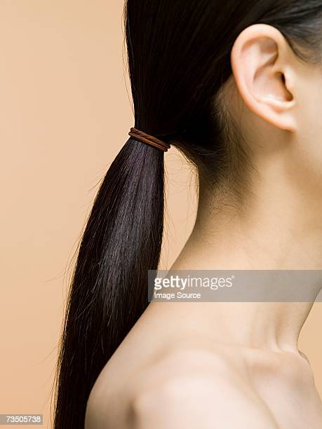 woman's ponytail - ponytail stock pictures, royalty-free photos & images