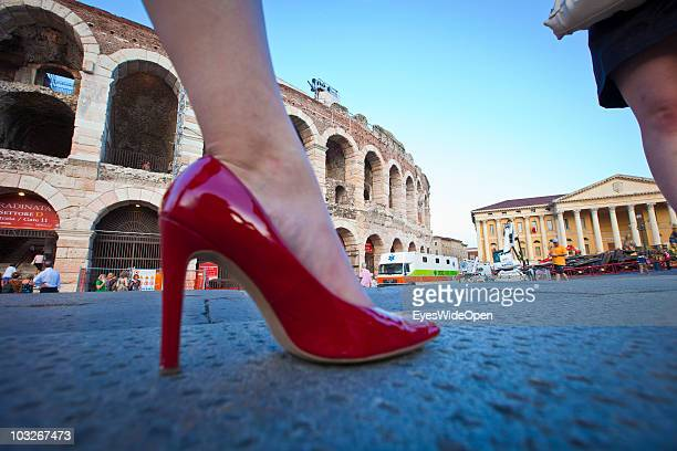 A woman´s red high heel shoe in front of the Arena of Verona on July 14 2010 in Verona Italy The famous Arena di Verona is popular for the annual...