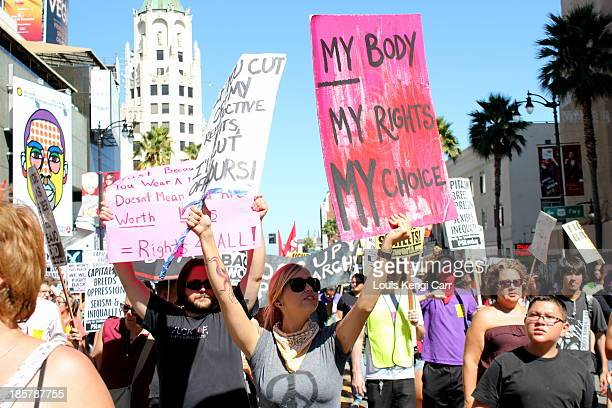 CONTENT] Woman's Rights March in Hollywood Protesters marching chanting and holding signs demanding the right of choice for their bodies
