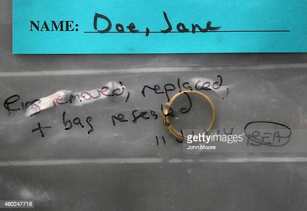 A woman's ring is kept in a sealed personal effects bag at the Pima County Office of the Medical Examiner on December 9 2014 in Tucson Arizona The...