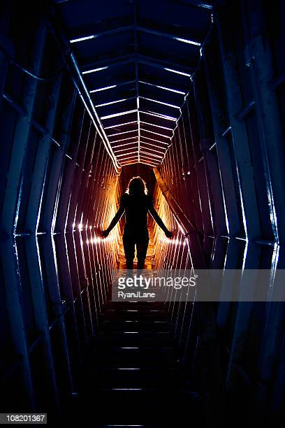 woman's silhouette in futuristic time travel tunnel - air raid shelter stock pictures, royalty-free photos & images