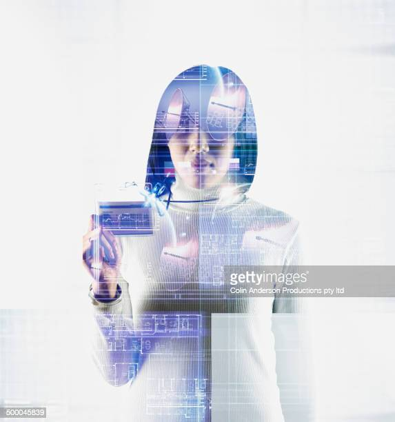 Woman's silhouette in reflection of servers