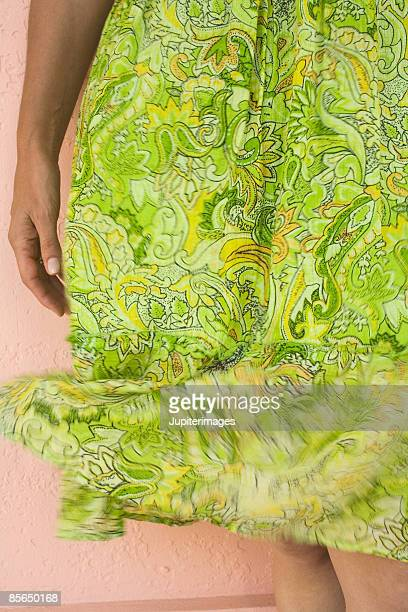 woman's skirt - wind blowing up skirts stock photos and pictures