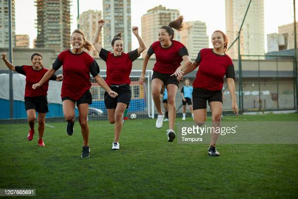 woman's soccer team celebrating scoring a goal. - the championship football league stock pictures, royalty-free photos & images