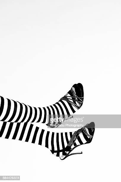 Woman's stiletto feet with Zebra-colored stockings