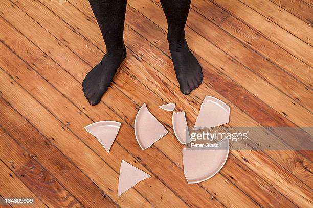 woman's stocking feet next to a broken plate - black women wearing pantyhose stock pictures, royalty-free photos & images