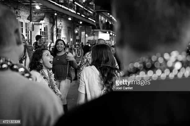woman's surprised facial expression on bourbon street - mardi gras flashing stock photos and pictures