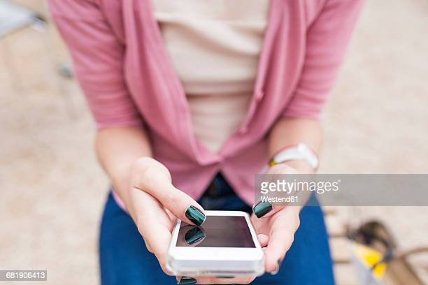woman's thumb typing on display of smartphone - thumb stock pictures, royalty-free photos & images