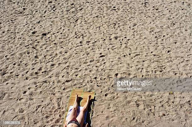 CONTENT] A woman's torso and legs can be seen from above She is in her bikini sunbathing on a beach in Cannes She's the only one on this stretch of...