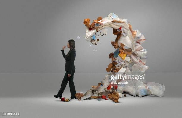 woman's trash threatens covers her - heap stock pictures, royalty-free photos & images