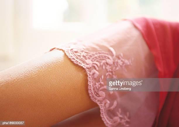 Woman's upper leg, lingerie, close up.
