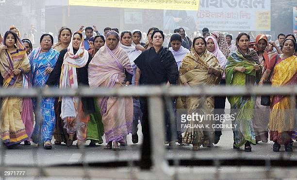 Women activists of Bangladesh main opposition Awami League party march towards a police barricade during a nationwide general strike called by the...