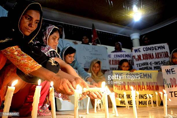 Women activists of Pakistan Tehreek-e-Insaf light candles to mark the tenth anniversary of 9/11 in Multan on September 10, 2011. The 9/11 attacks...