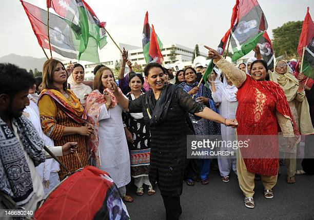 Women activists of the ruling Pakistan People's Party dance as they celebrate the election of Raja Pervez Ashraf as Pakistan's new prime minister...