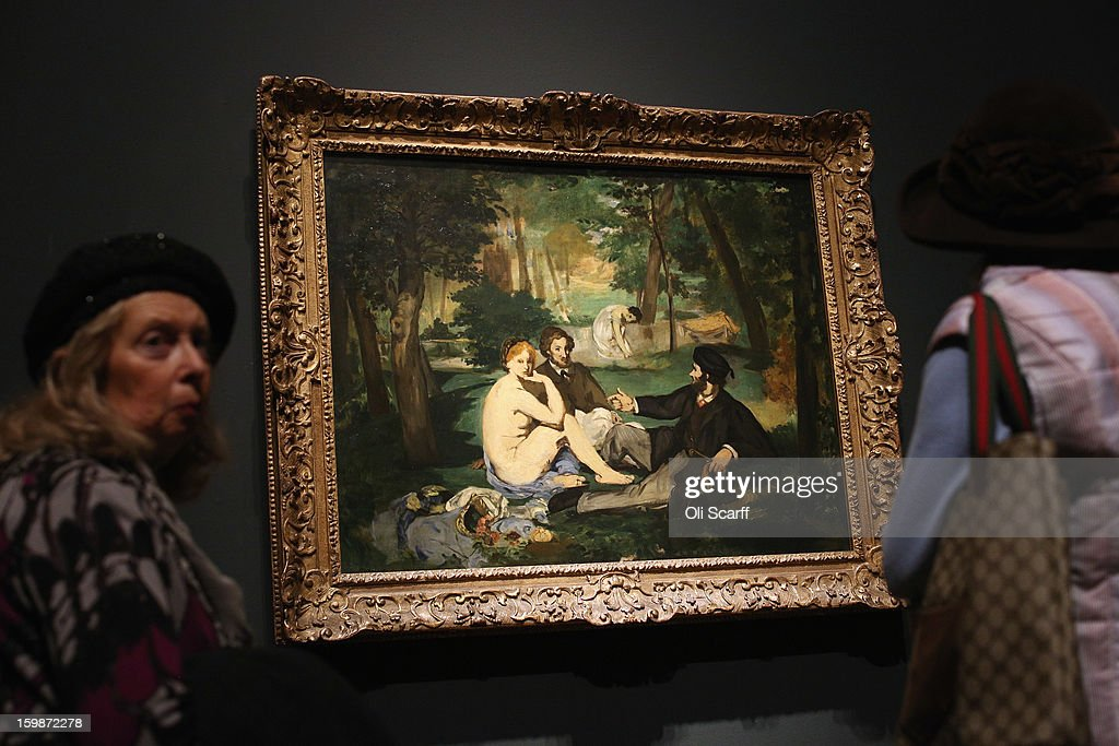 Women admire a painting by Edouard Manet entitled 'Dejeuner sur l'herbe' in the Royal Academy of Arts on January 22, 2013 in London, England. The painting features in the Royal Academy's new exhibition 'Manet: Portraying Life' which displays over 50 paintings spanning his career. The exhibition open to the general public on January 26, 2013 and runs until April 14, 2013.