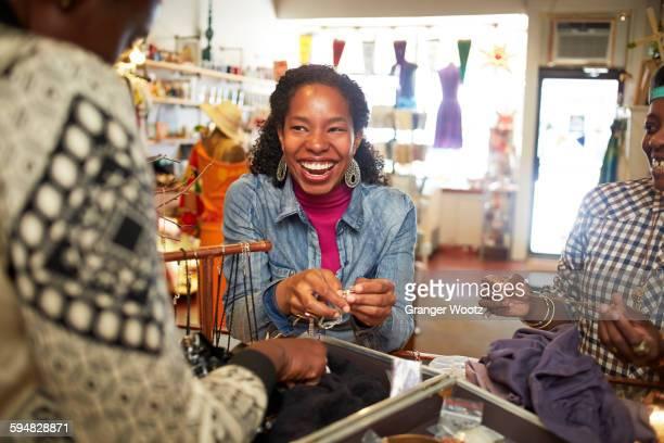 Women admiring jewelry in store