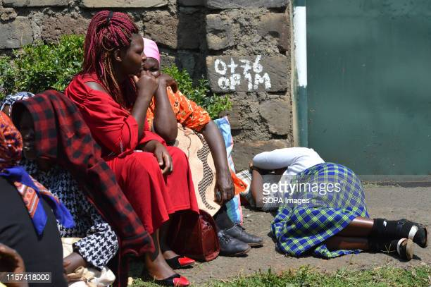 Women affected by the post poll violence are seen resting after hearing of the main case to seek compensation was suspended pending confirmation of...