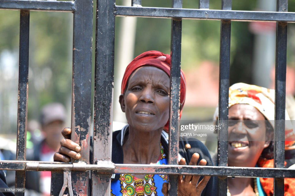 Women affected by the post poll violence look on through an... : News Photo