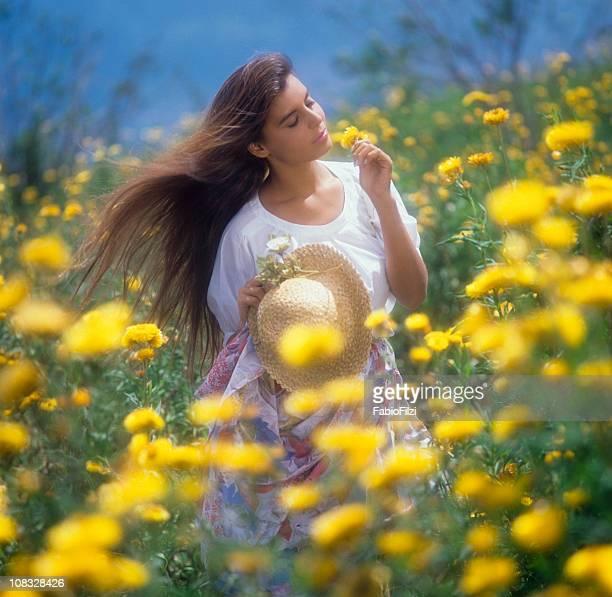 women among the flowers in meadow