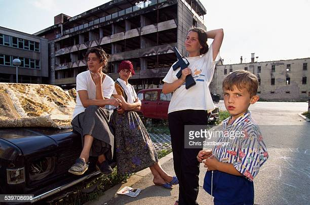 Women and a boy outside a public housing block in Sarajevo