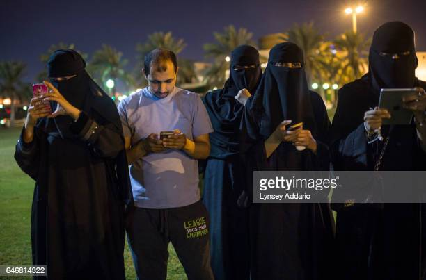 Women and a man in a park at night on March 19 2015