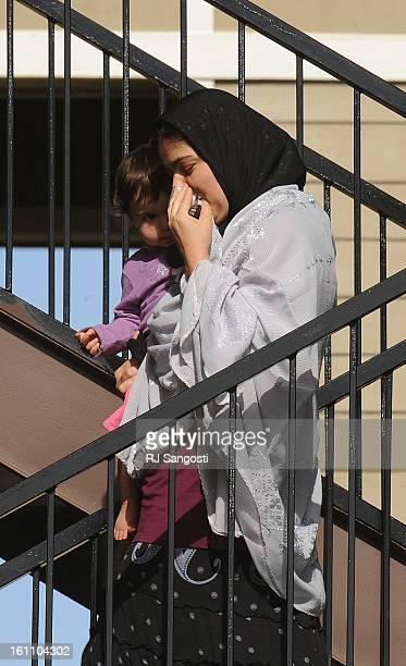 ZAZI19A women and child leave the apartment of Najibullah Zazi at the Vistas apartment complex in Aurora on Saturday Media reporters were camped out...