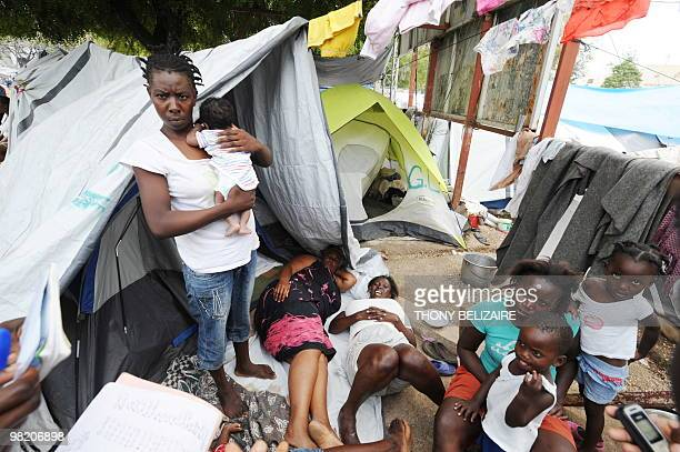 Women and children are seen on April 01 2010 in a tent city of PetionVille a neighborhood of PortauPrince The global community has pledged nearly 10...