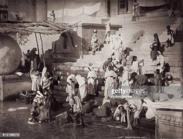 Women and children bathing at a ghat on the banks of the Ganges in Benares Uttar Pradesh India circa 1875 Vintage albumen print