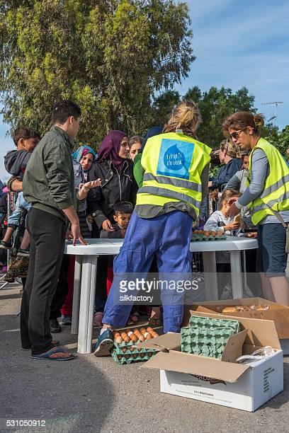 Women and children breakfast line in Greek Island refugee camp