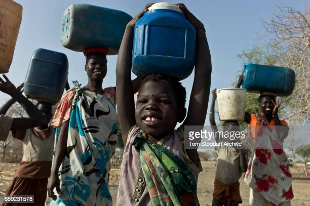 Women and children collect water at Wara village in Pariang County in Unity State South Sudan where the International Committee of the Red Cross have...