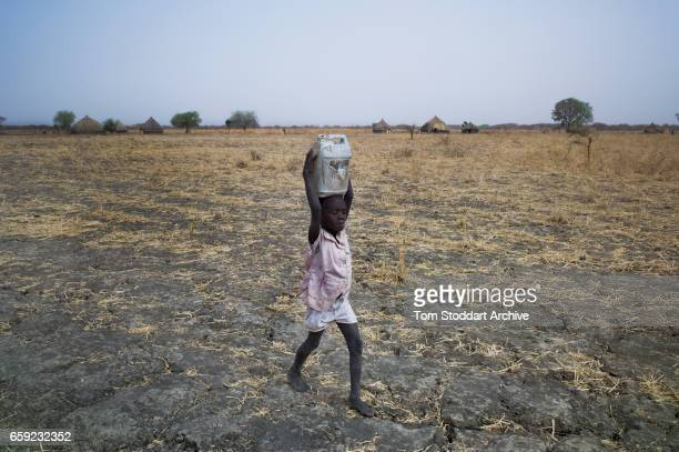 Women and children collect water at Wengoth village in Pariang County in Unity State South Sudan where the International Committee of the Red Cross...