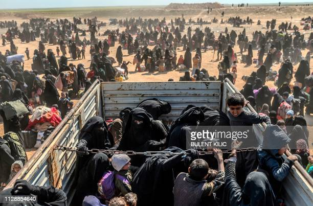 TOPSHOT Women and children evacuated from the Islamic State group's embattled holdout of Baghouz arrive at a screening area held by the USbacked...