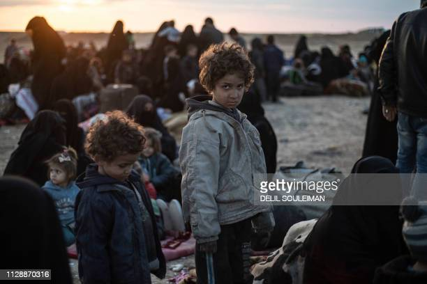 Women and children evacuated from the Islamic State group's embattled holdout of Baghouz arrive at a screening area held by the USbacked Kurdishled...