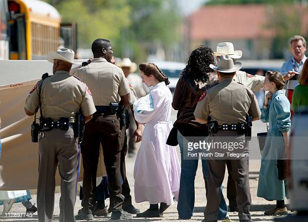 Women and children from the YFZ Ranch the compound built by polygamist leader Warren Jeffs are moved by bus to San Angelo Texas on Sunday April 6...