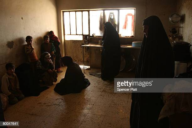 Women and children gather in a room in a village which was purged of insurgents hours before February 28 2008 in Abu Seer Iraq Abu Seer is the first...