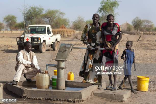 Women and children photographed collecting water at Wara village in Pariang County in Unity State South Sudan where the International Committee of...