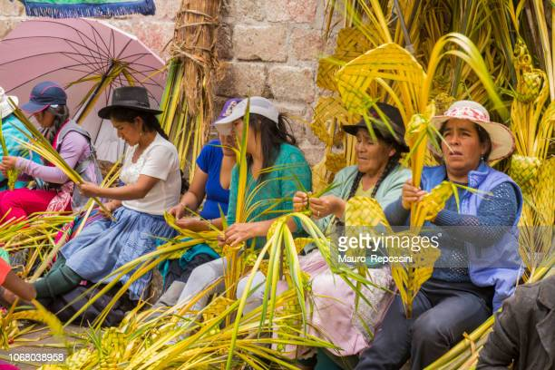 women and children preparing floral offerings to celebrate palm sunday in holy week at ayacucho city, peru. - palm sunday stock pictures, royalty-free photos & images