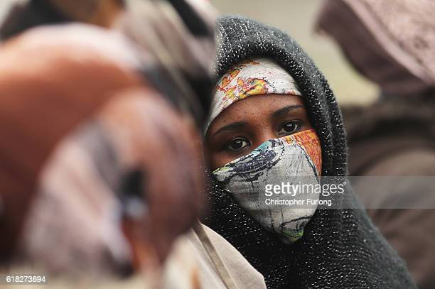Women and children protest their case to the UK goverment at the notorious Jungle camp as migrants leave and the authorities demolish the site on...