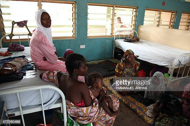 Women and children rescued by Nigerian soldiers from Islamist militants Boko Haram at Sambisa Forest wait to receive treatment at the Federal Medical...