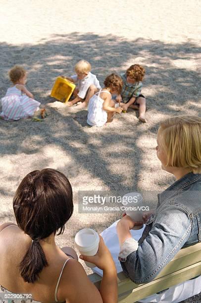 Women and children sitting in park