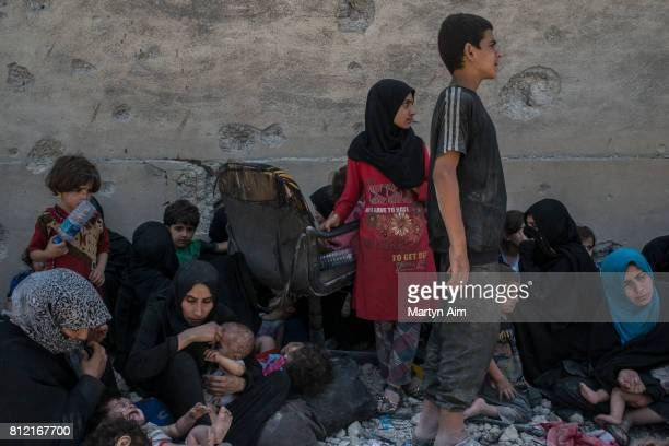 Women and children suspected to be the families of Islamic State fighters are held by Iraqi forces in the Old City district on July 10 2017 in Mosul...