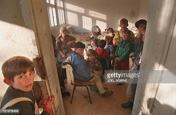 Women and children take refuge in a school in Tushila 100kms from Pristina 21 March 1998 Electors in Serbia began voting in a referendum 23 April...