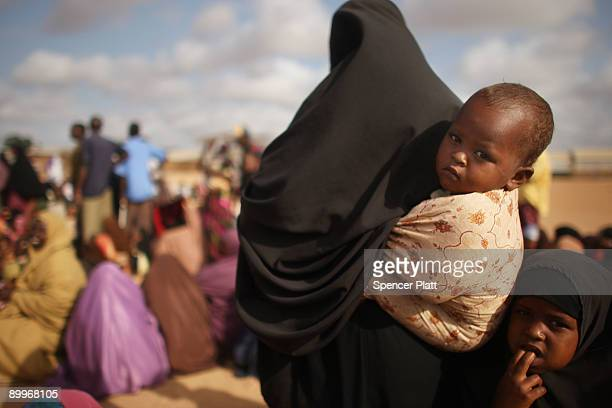 Women and children wait in line at a processing center for new arrivals in Dadaab, the world�s biggest refugee complex August 20, 2009 in Dadaab,...