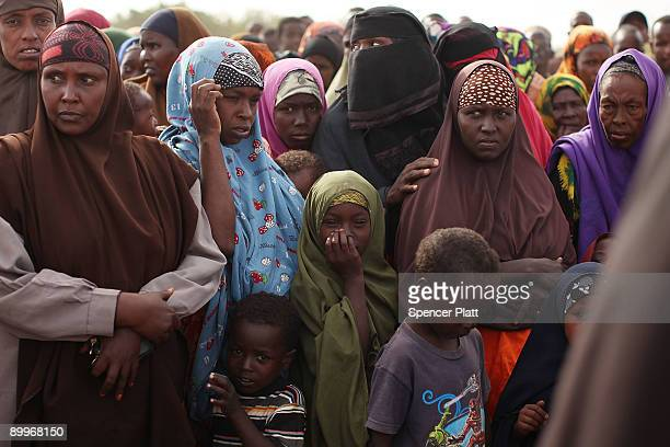 Women and children wait in line at a processing center for new arrivals in Dadaab, the world�s biggest refugee camp August 20, 2009 in Dadaab, Kenya....