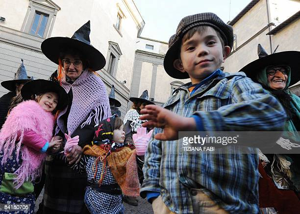 Women and children wearing Befana outfits take part in the annual Befana parade in Viterbo on January 5 the day before Epiphany A 52 meter long...