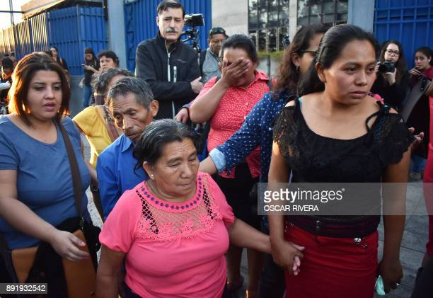 Women and family members cry outside the Isidro Menendez Judicial Center after a hearing held to review the sentence handed down to Theodora de...