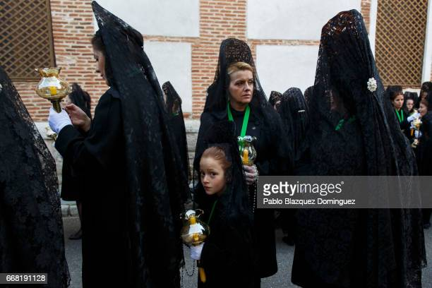Women and girls wearing 'mantilla' from the Virgen de la Esperanza brotherhood take part in a procession on April 13 2017 in Zamora Spain Spain...